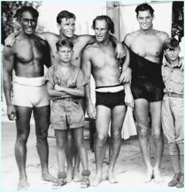 Duke with actor Buster Crabbe (2nd rear) and actor/olympian Johnny Weissmuller (first movie Tarzan, far right)